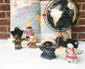 PeaceKins around a globe and map